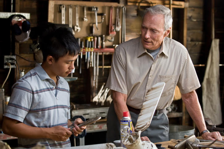 (L-r) Thao (BEE VANG) and Walt Kowalski (CLINT EASTWOOD) in Warner Bros. Pictures and Village Roadshow Pictures drama Gran Torino, distributed by Warner Bros. Pictures.