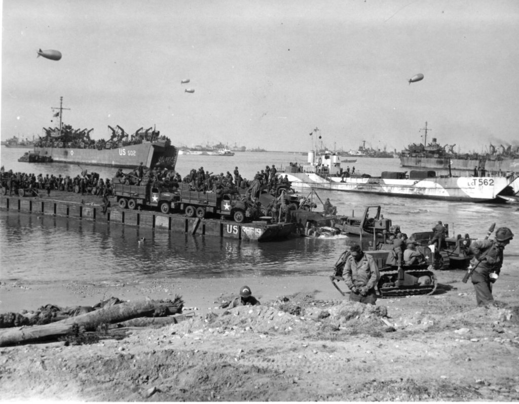 The 111th Naval Construction Battalion landing at Omaha Beach before the Mulberry was installed, 6 June 1944.