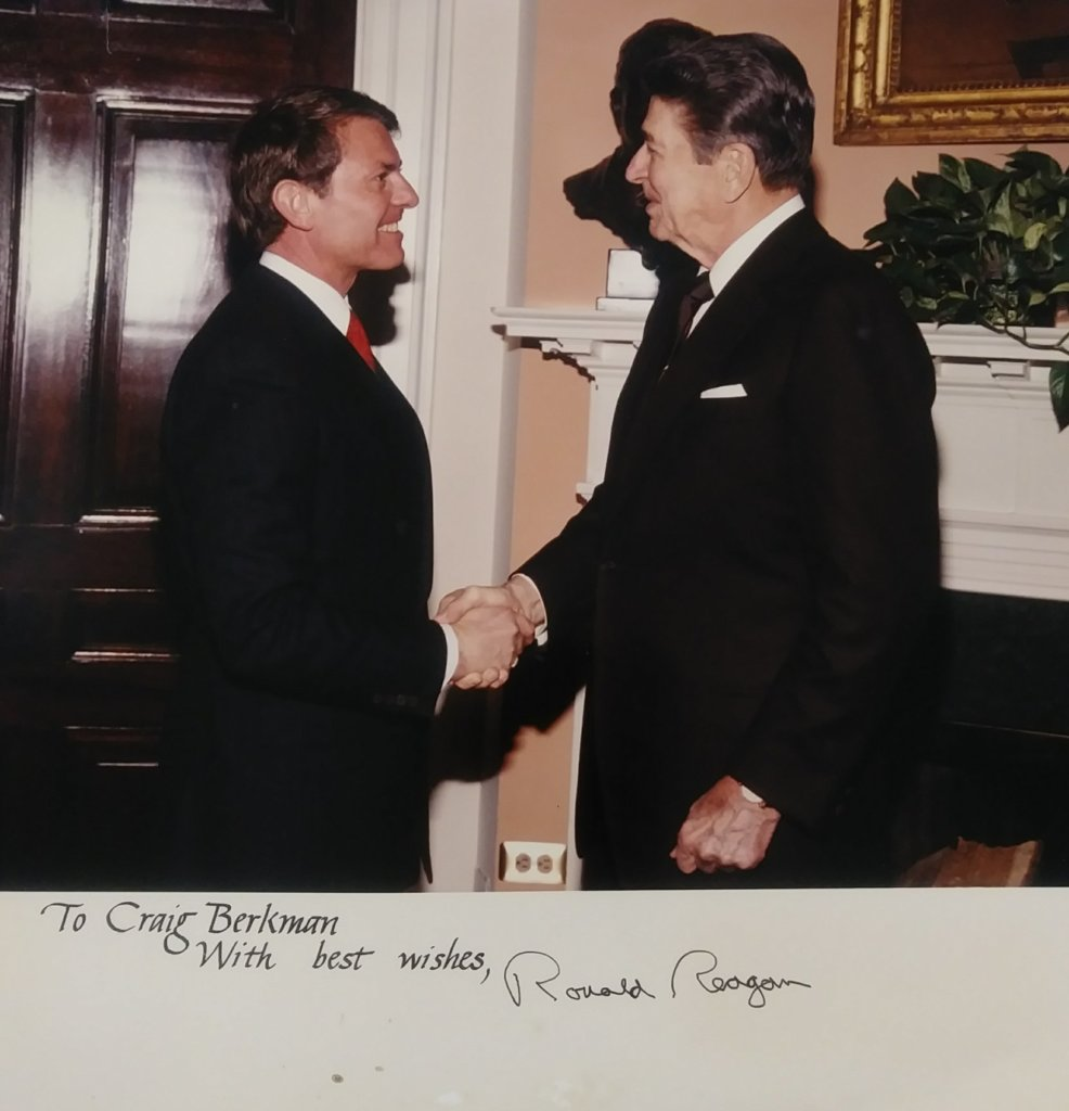 Ronald Regan shakes Craig Berkman's hand