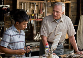 (L-r) Thao (BEE VANG) and Walt Kowalski (CLINT EASTWOOD) in Warner Bros. PicturesÕ and Village Roadshow PicturesÕ drama ÒGran Torino,Ó distributed by Warner Bros. Pictures. PHOTOGRAPHS TO BE USED SOLELY FOR ADVERTISING, PROMOTION, PUBLICITY OR REVIEWS OF THIS SPECIFIC MOTION PICTURE AND TO REMAIN THE PROPERTY OF THE STUDIO. NOT FOR SALE OR REDISTRIBUTION.